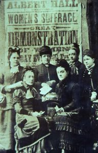It is believed, but is not certain, that Alice Cliff Scatcherd is amongst this group of suffragettes. Photograph not placed on the Leodis website.DKA text: During the 1870s, 1880s and 1890s, Alice Cliff Scatcherd was one of the great pioneers of the Women's Suffrage Movement, writing many letters to the press and helping to organise numerous demonstrations in many big cities to bring forward the need for women to have the vote. She is on the photograph of six of their members who were attending a demonstration at the Albert Hall in London. It is not certain which is Alice Cliff Scatcherd but, possibly she is the one seated on the right at the front.